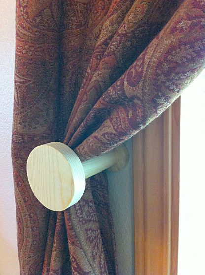 ActionCraftworks.com circle curtain holdback curtain angle