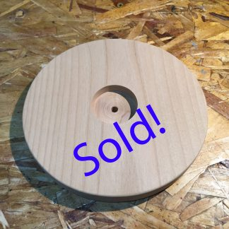 "6.5"" x 3/4"" Alder circle with 1-5/8"" x 3/8"" countersunk and 1/4"" hole"
