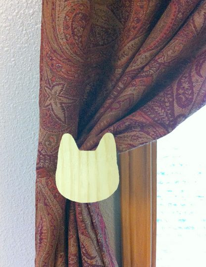 ActionCraftworks.com cat head curtain holdback curtain front