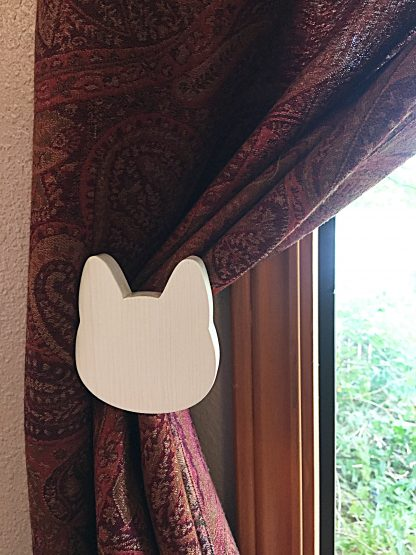 ActionCraftworks.com White cat head curtain holdback installed